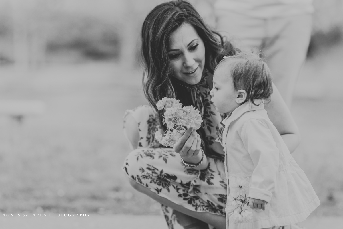 mom holding a flower for her toddler daughter | cleveland, lifestyle family photography