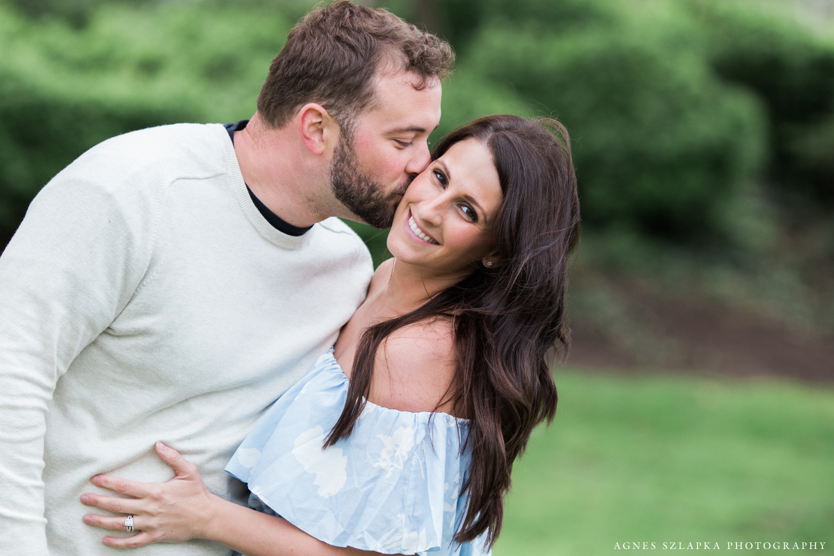 husband kissing his wife on cheek | cleveland, ohio couple photographer