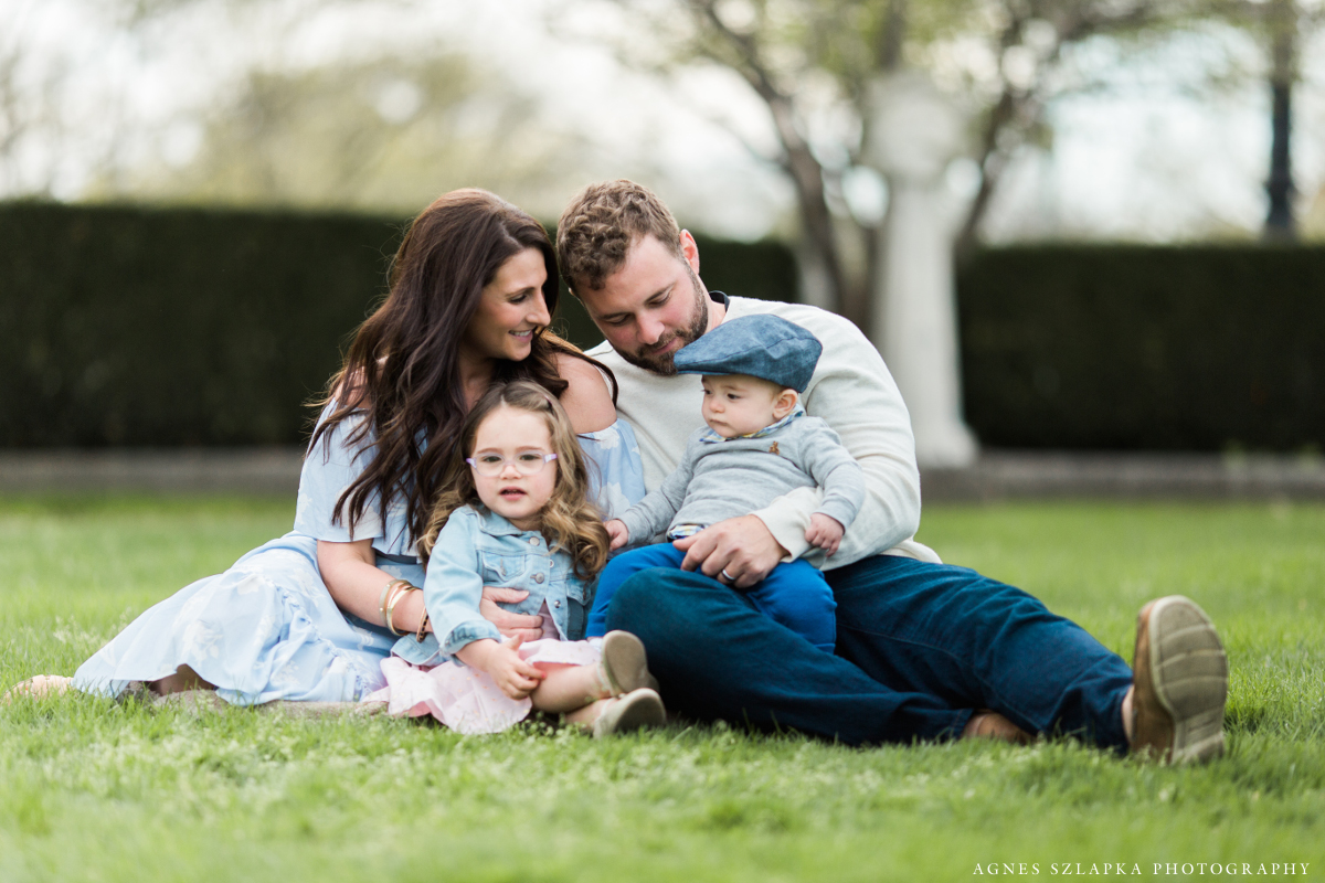 parents with two small children sitting on grass | cleveland, ohio family photographer