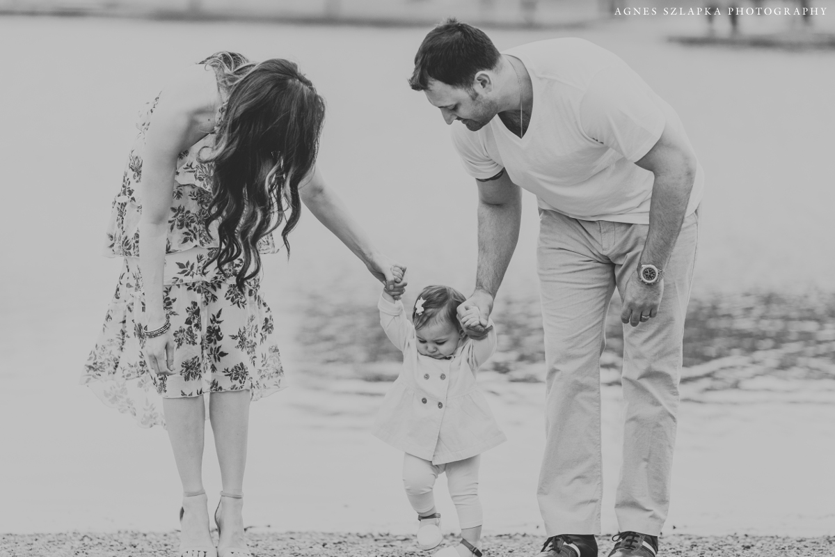 mom and dad holding small little girls hands | cleveland, ohio family photography