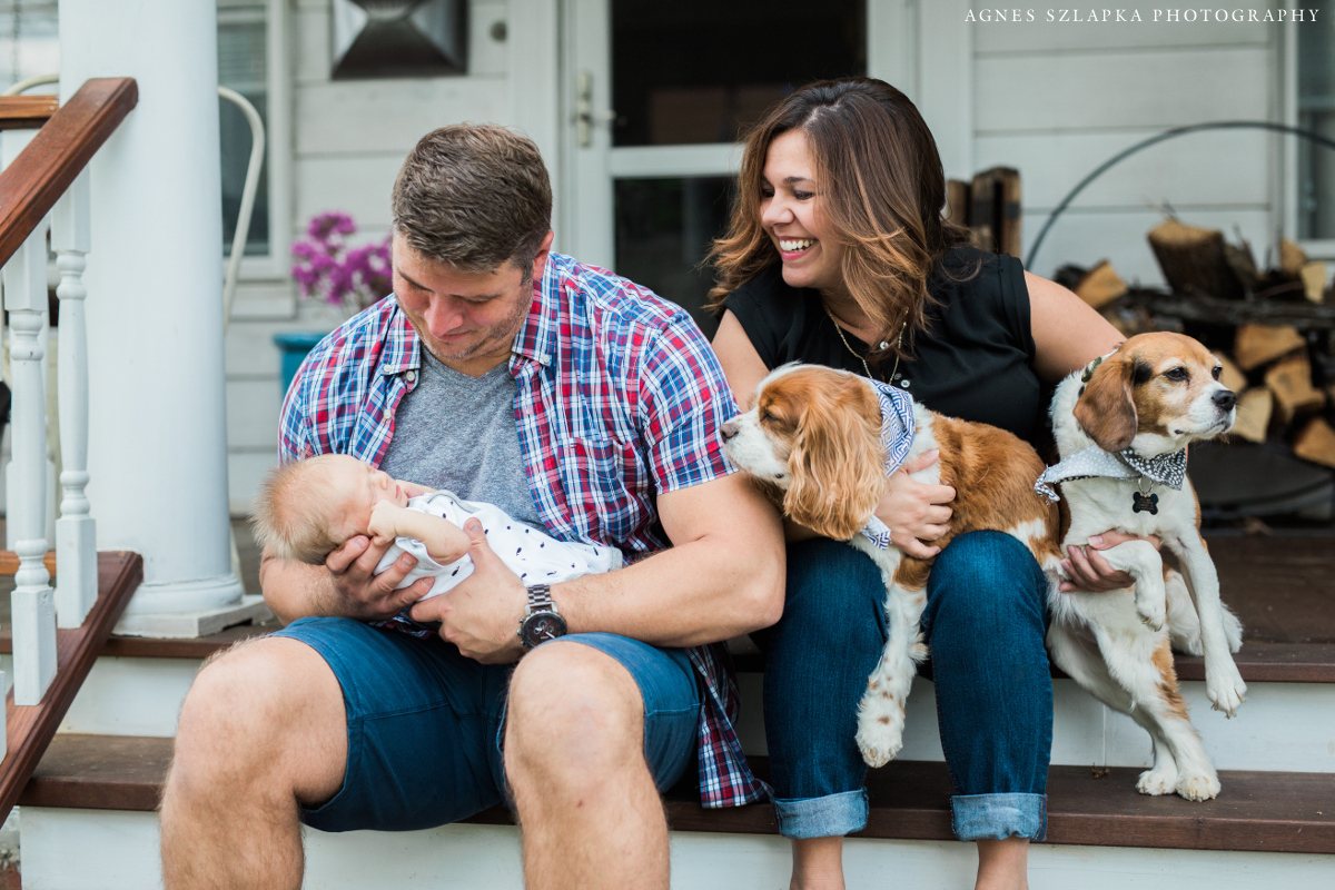 family of three and dogs on front porch | cleveland, newborn lifestyle photographer