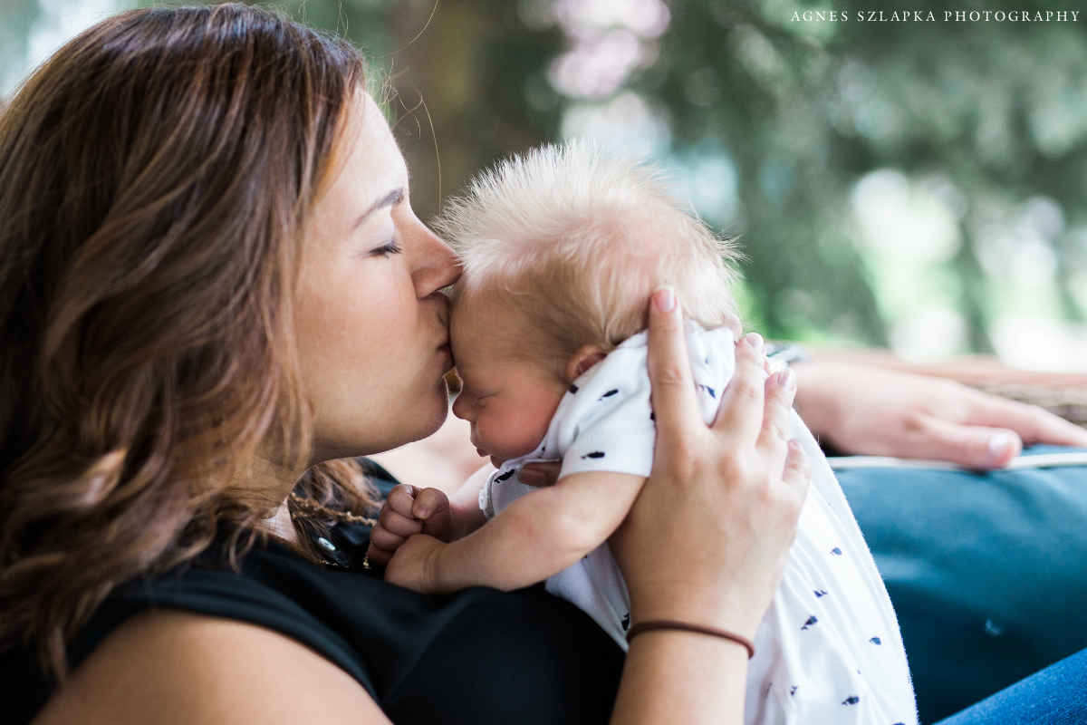 new mom kissing her baby son | cleveland, ohio newborn photographer