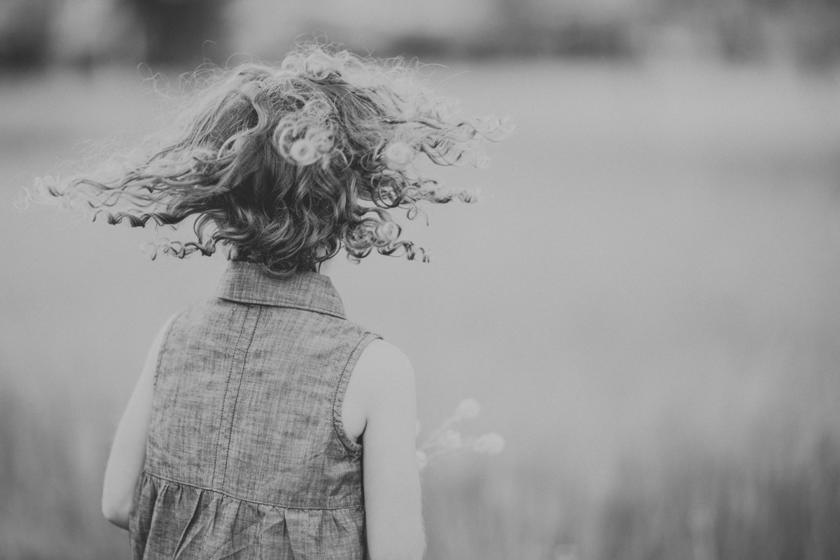 little girl twirling around in park | cleveland, ohio lifestyle family photographer