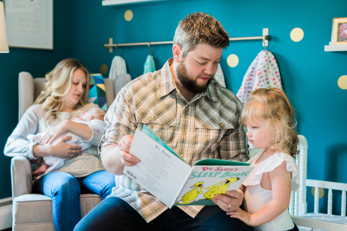 dad reading a book to his three year old daughter | cleveland, oh lifestyle family photographer