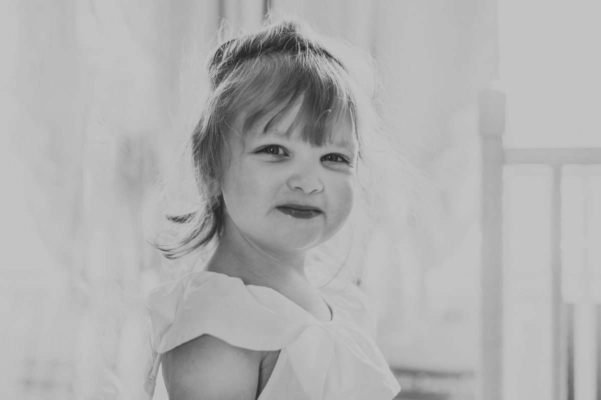 three year old girl with blonde hair near window | cleveland, oh family photos