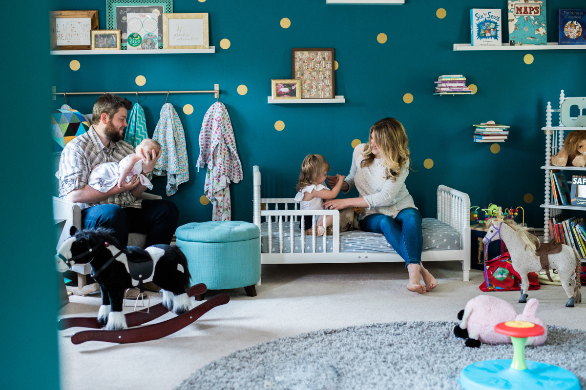 family of four in daughters bedroom having fun | cleveland, oh family lifestyle photography
