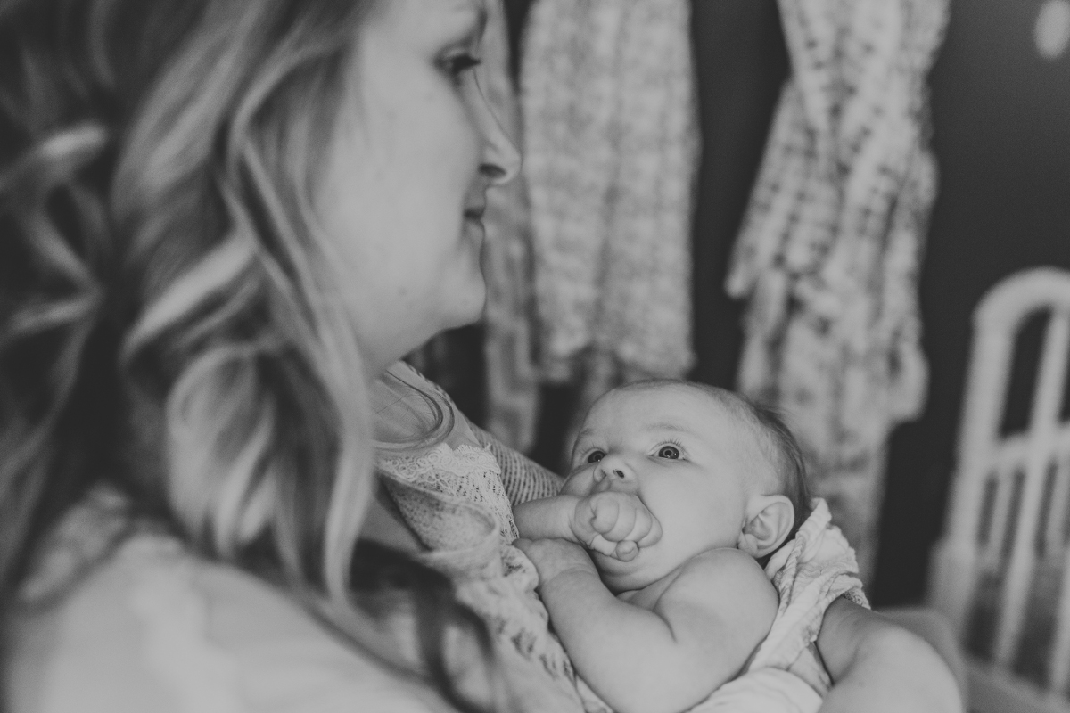 mom holding infant baby daughter | cleveland, oh family photographer