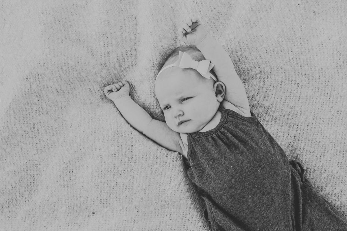 sweet baby newborn girl in gray onesie | cleveland, oh family photographer