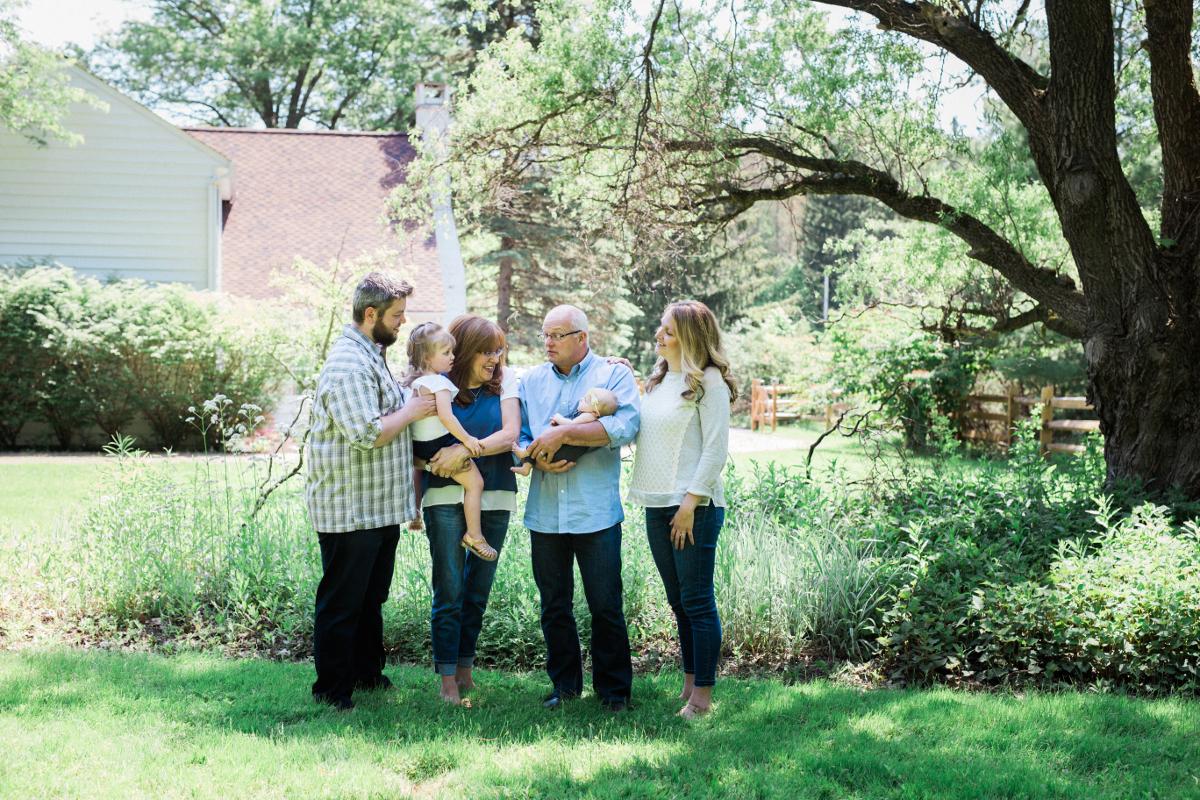 grandparents with children and grandchildren in garden talking | cleveland family photography