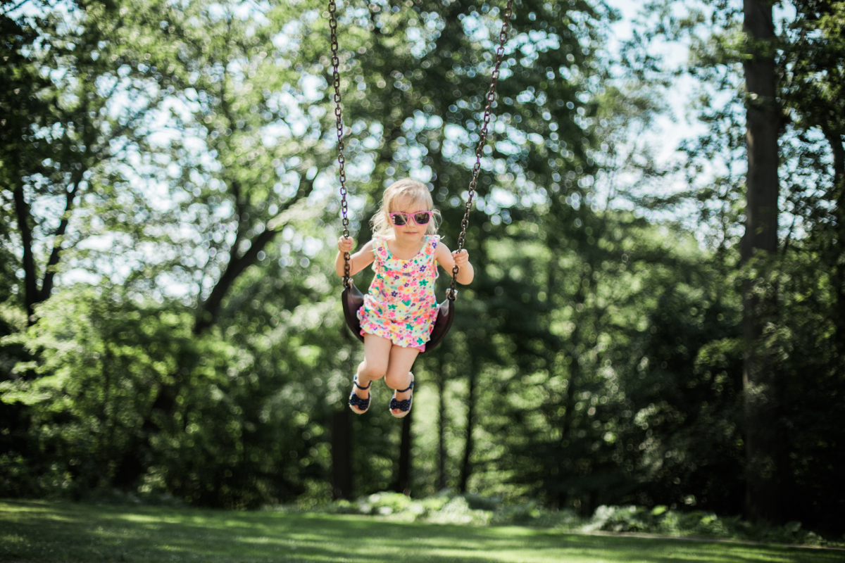 little girl swinging on swing | shaker heights family photographer