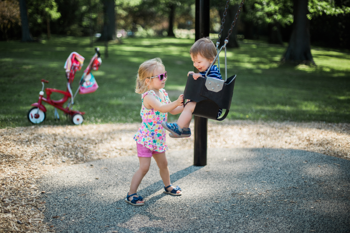 big sister swinging little brother | shaker heights family photographer