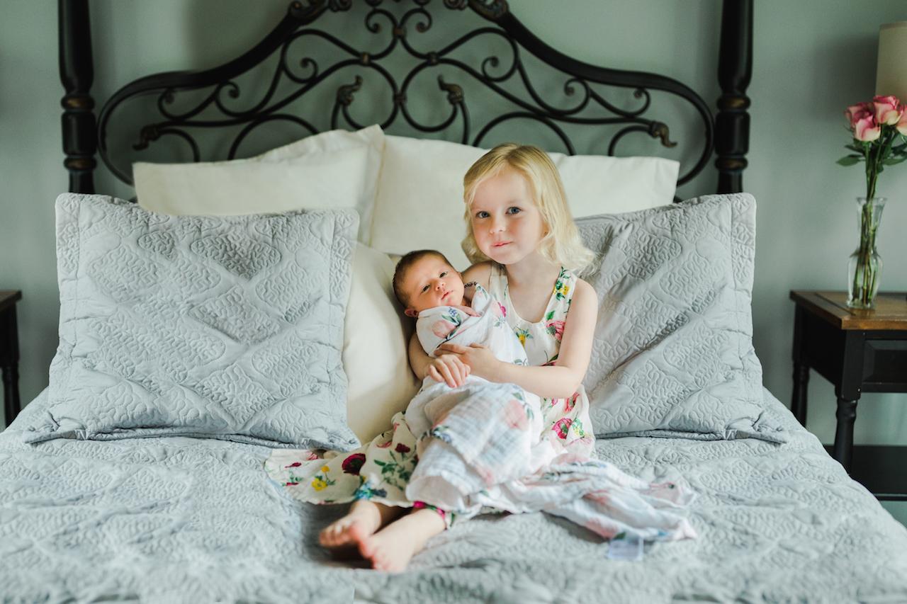 big sister holding baby sister | cleveland, ohio newborn photographer