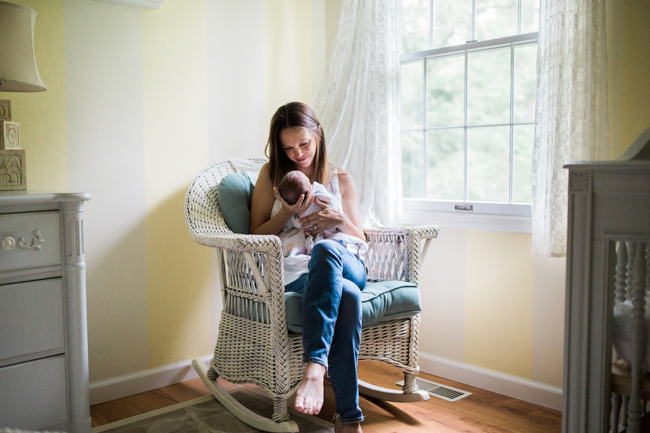 mom and baby girl in nursery | cleveland newborn lifestyle photography