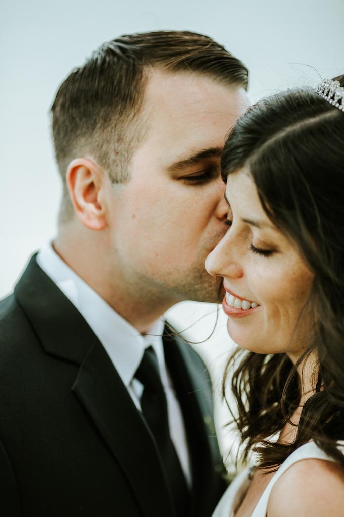 husband to be kissing future wife in lakewood | cleveland, ohio wedding photographer