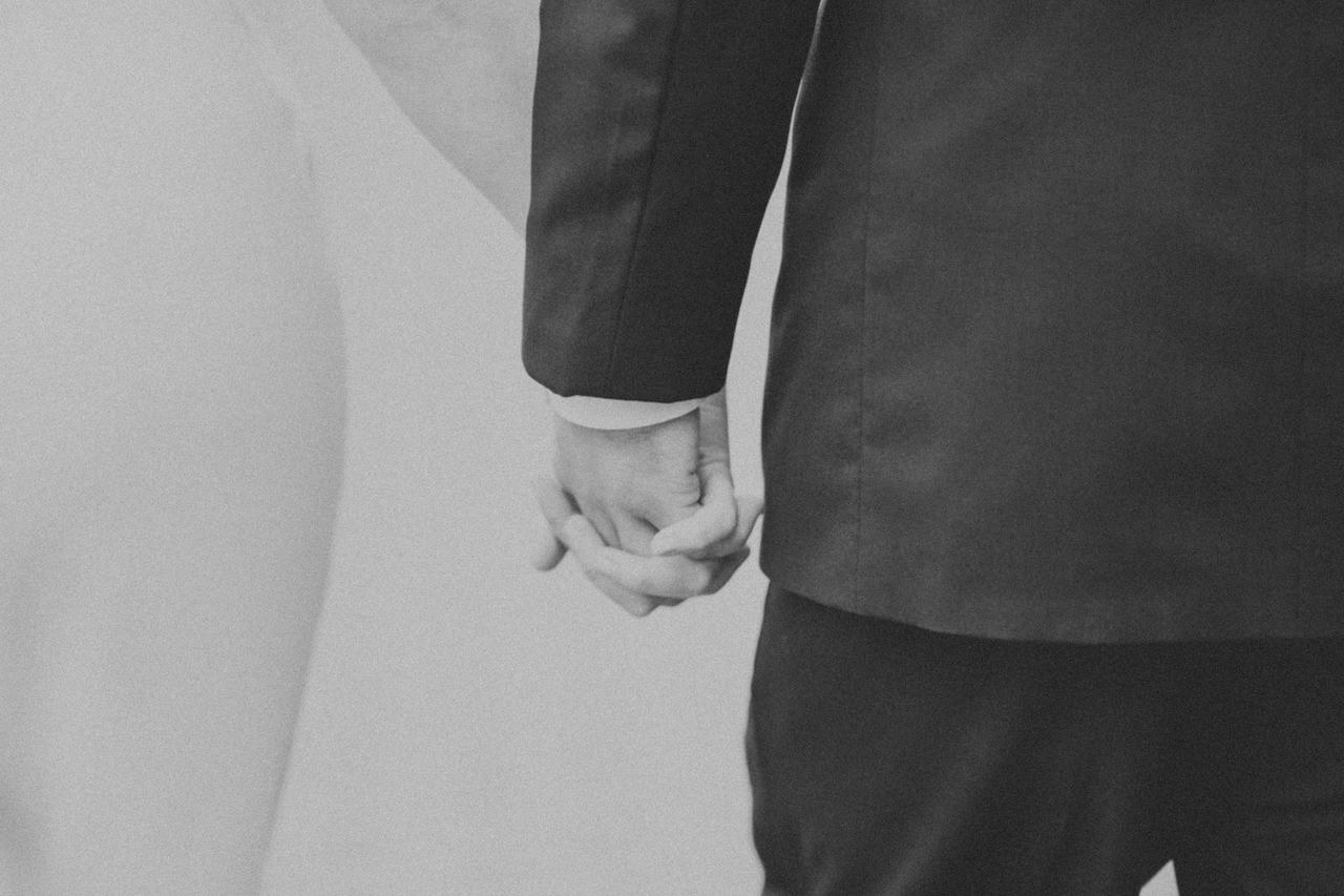 man and woman holding hands   cleveland ohio wedding photographer