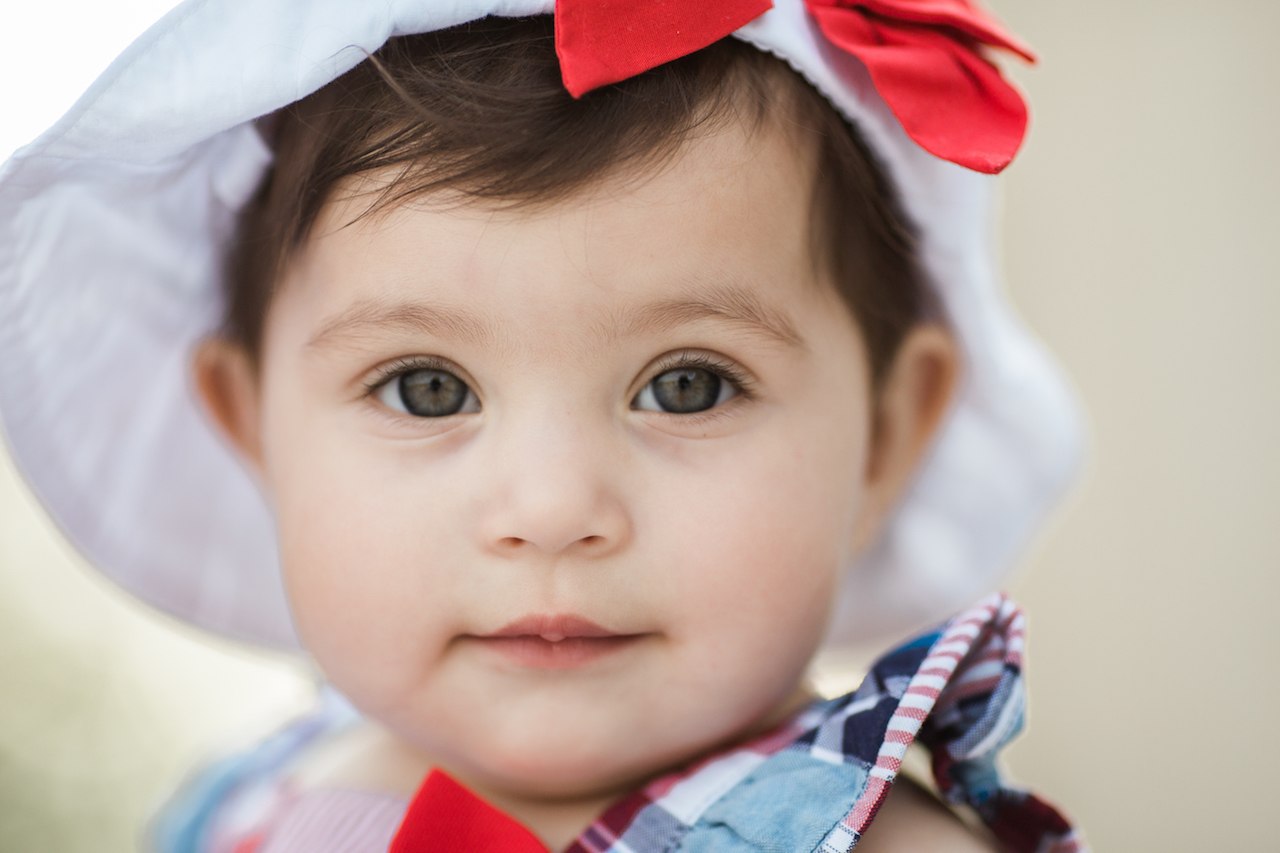 nine month old baby girl with hat | cleveland, ohio family photographer