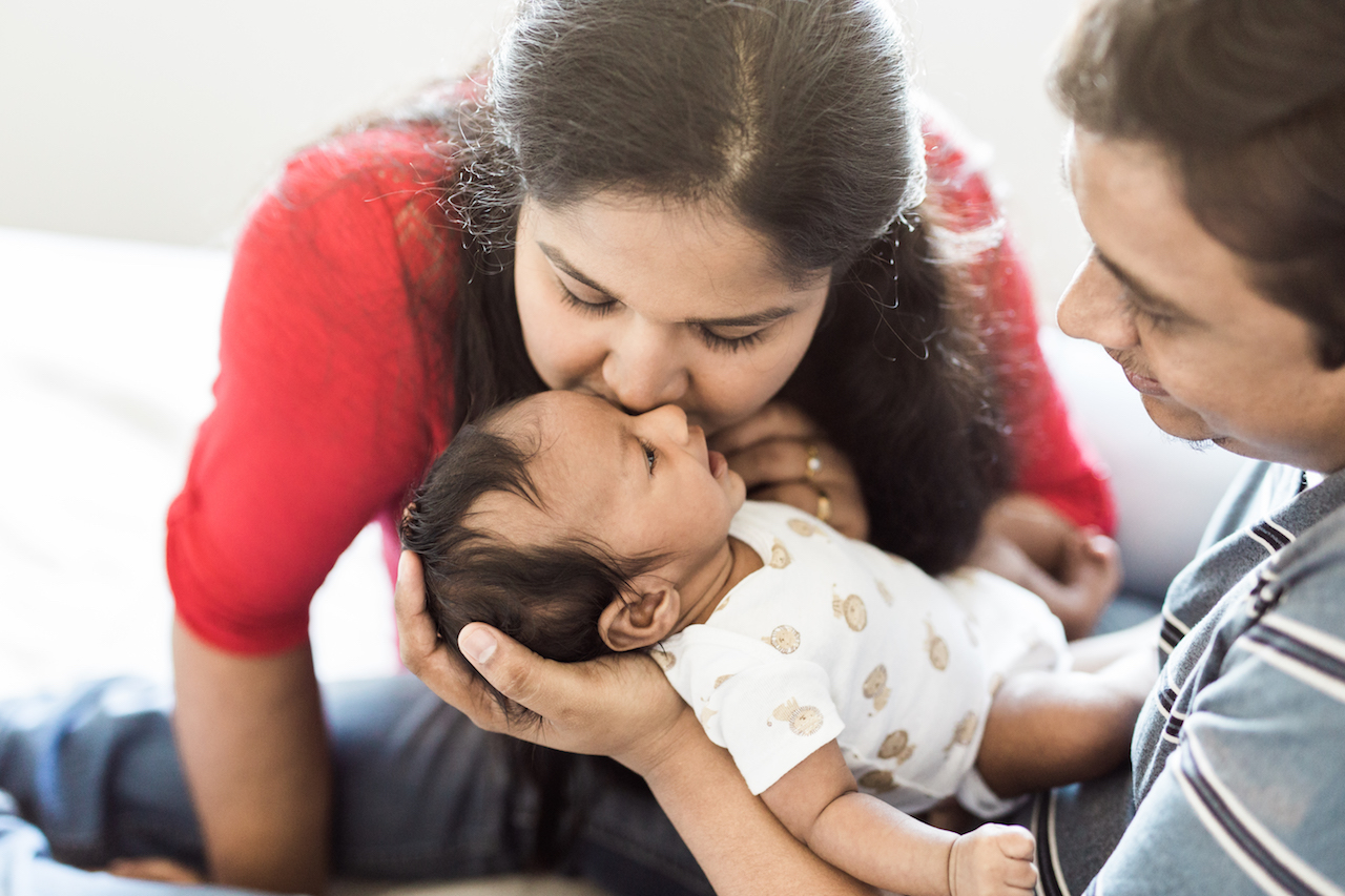 family of three with baby boy in arms | cleveland, ohio newborn photography