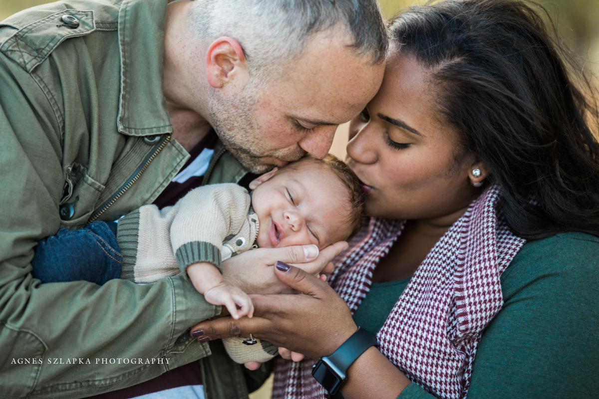parents kissing head of newborn baby boy | cleveland, OH baby photos