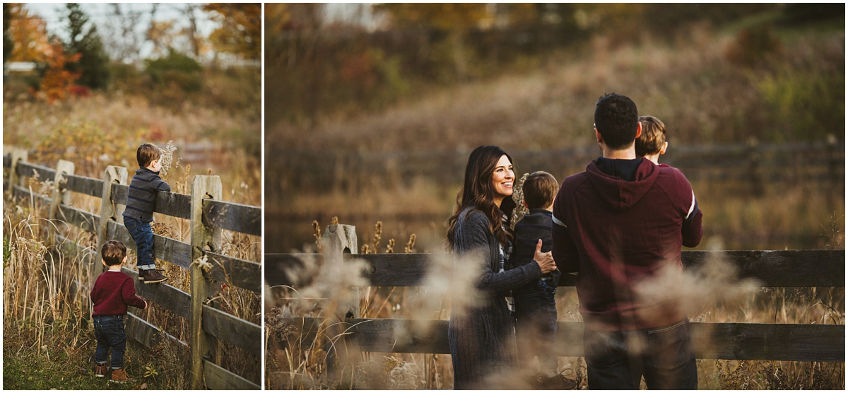 two boys climbing fence in beachwood park | cleveland, OH family lifestyle photographer