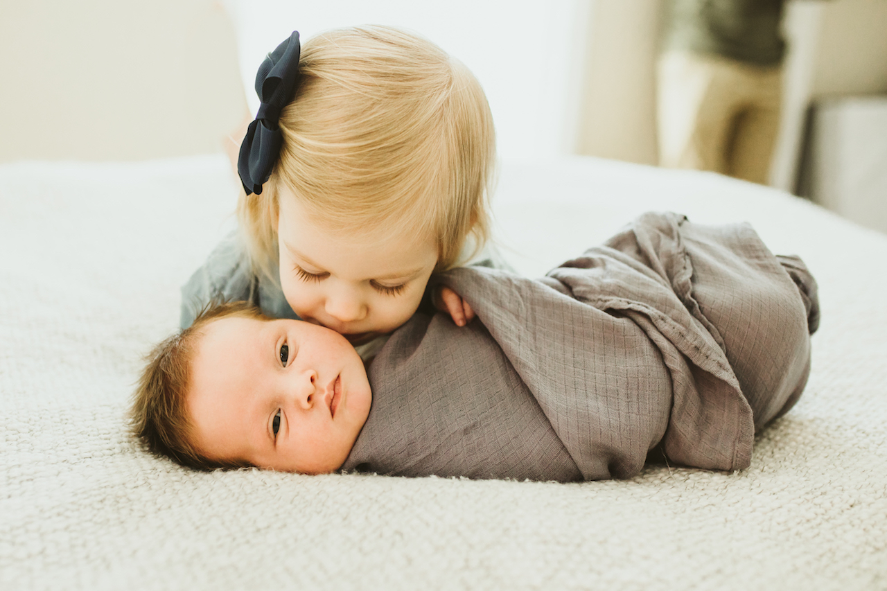 big sister kissing infant brother | Cleveland, Newborn photographer
