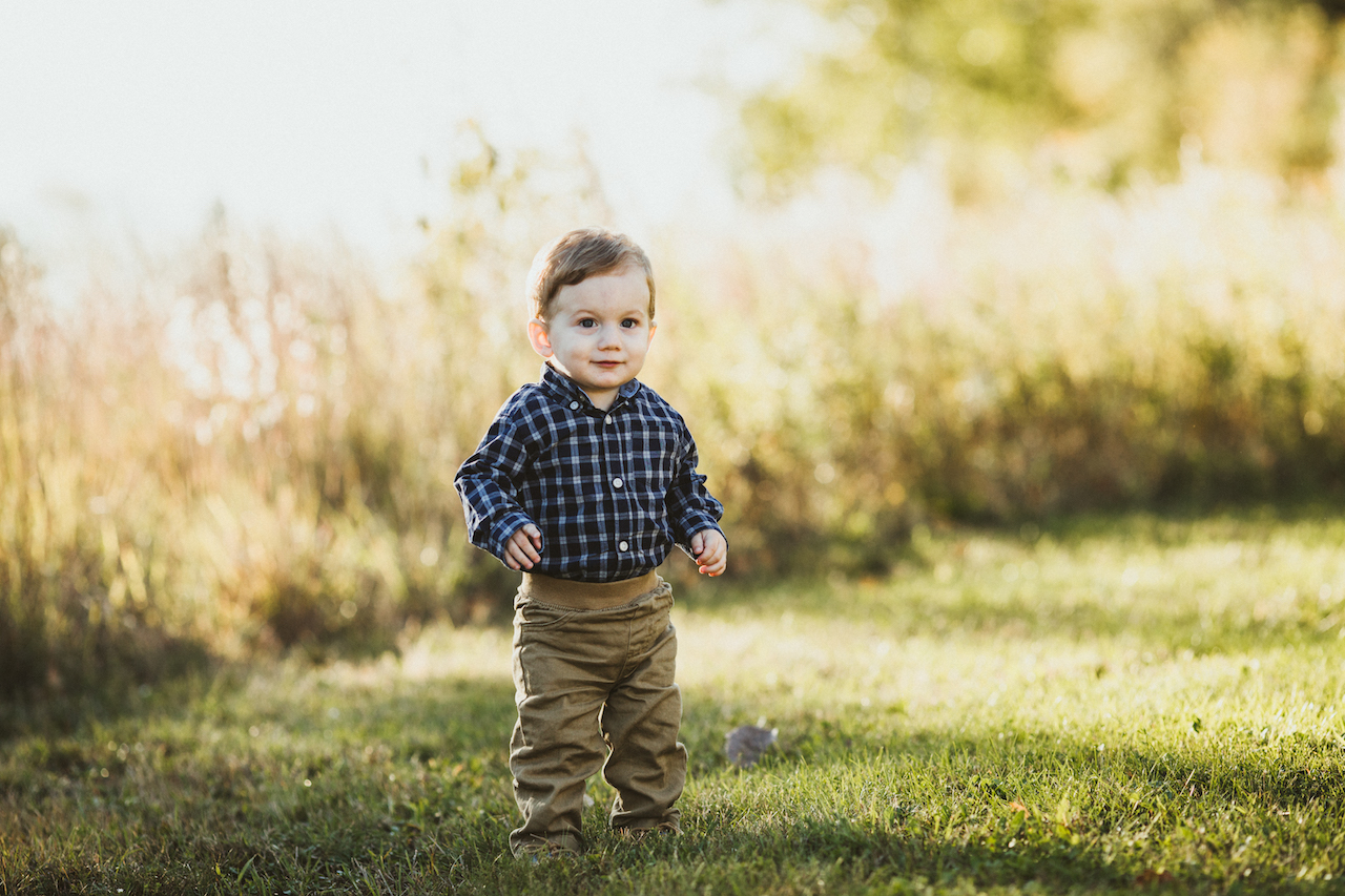 one year old boy with blue shirt standing | Cleveland Family Photographer