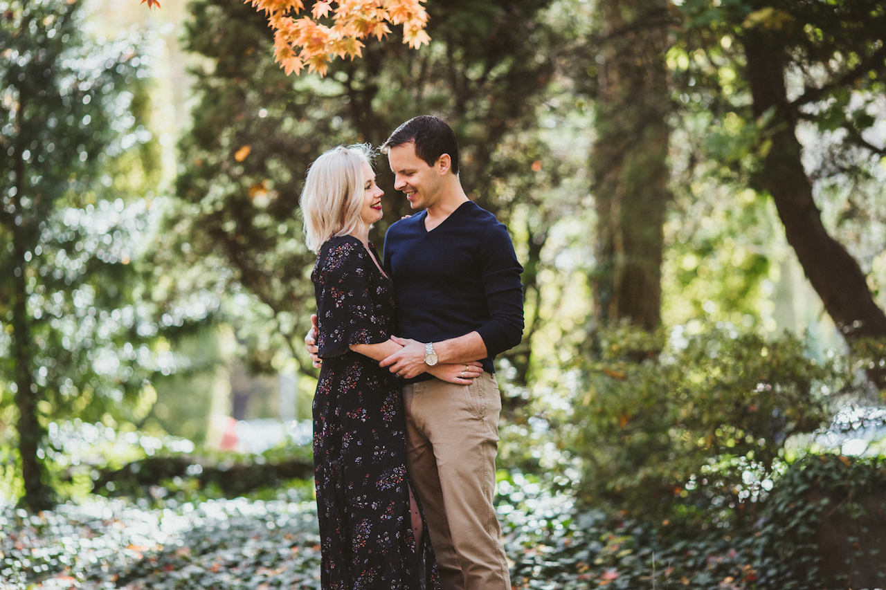 husband and wife in Rockefeller Greenhouse garden | Cleveland, OH family photographer