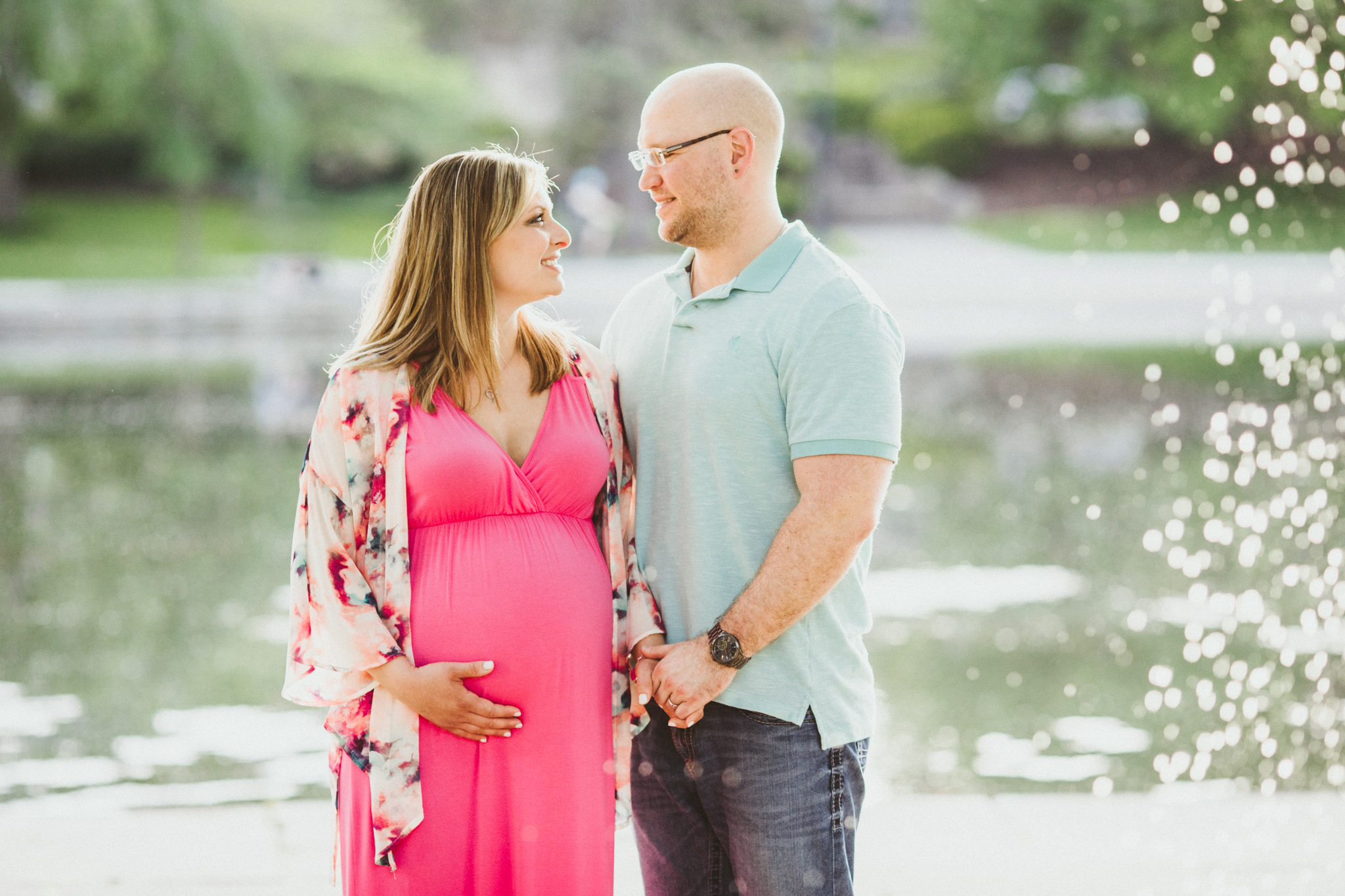 pregnant wife in pink dress by fountain | Cleveland, OH maternity photographer