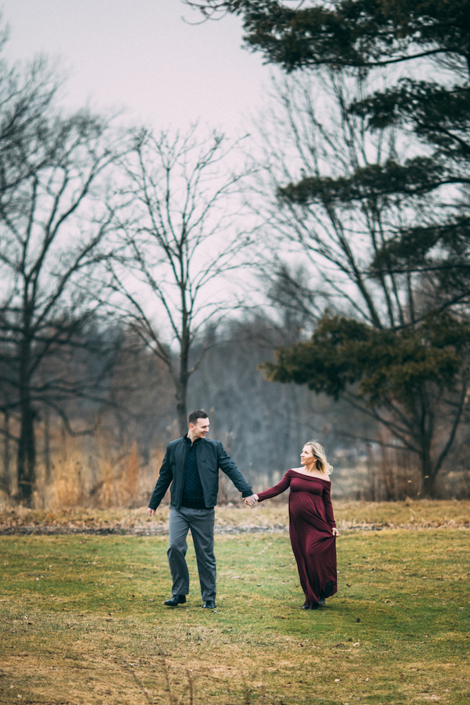 soon to be parents walking in park | Cleveland, OH maternity photographer