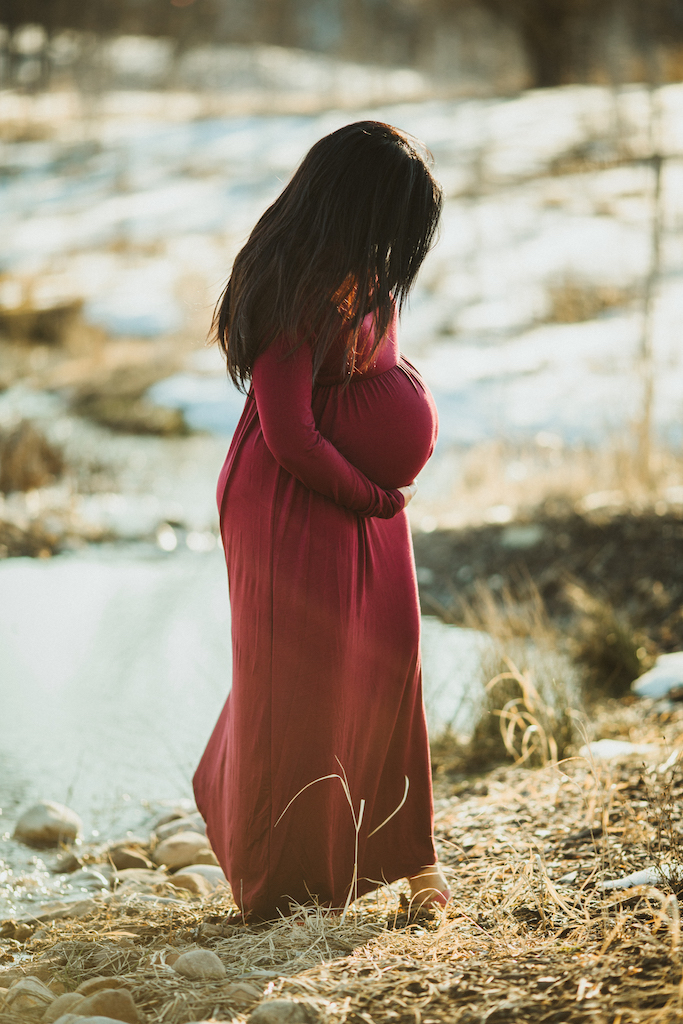 beautiful pregnant woman in winter dress | Cleveland, OH maternity photographer