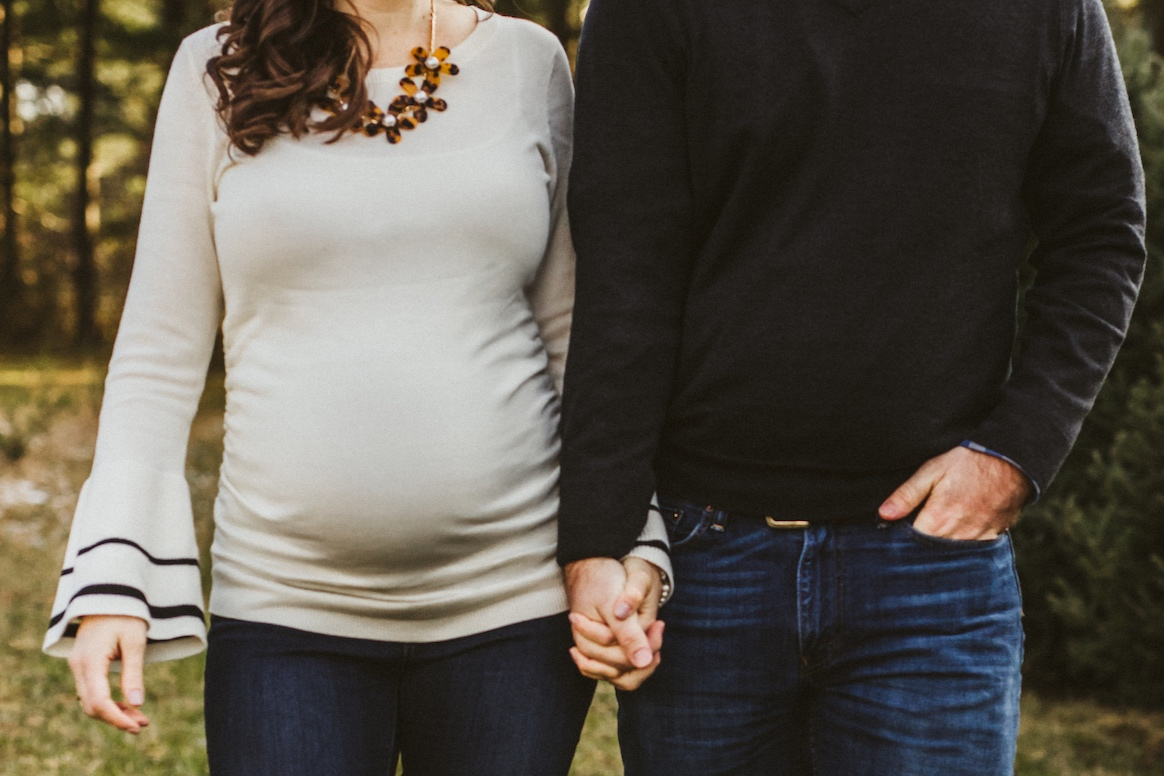 holding hands of soon to be parents | Cleveland, OH maternity photographer