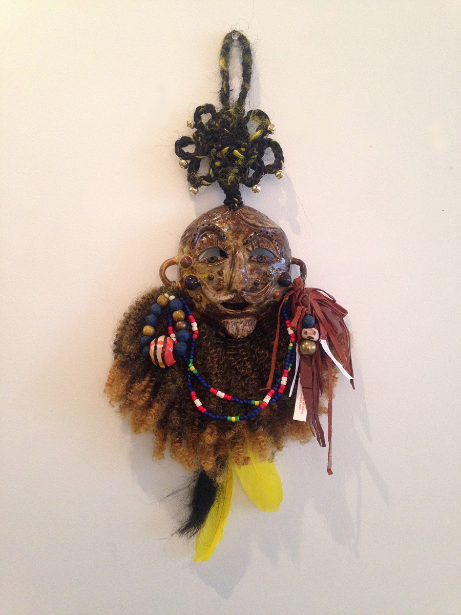 "Jiha Moon  Baba , 2015 Earthenware ceramic, wire, hand-knotted synthetic hair, feathers, leather, Hanji beads, digitally printed fortune cookie inserts, bells, found objects 23"" x 10"" x 2.5"""