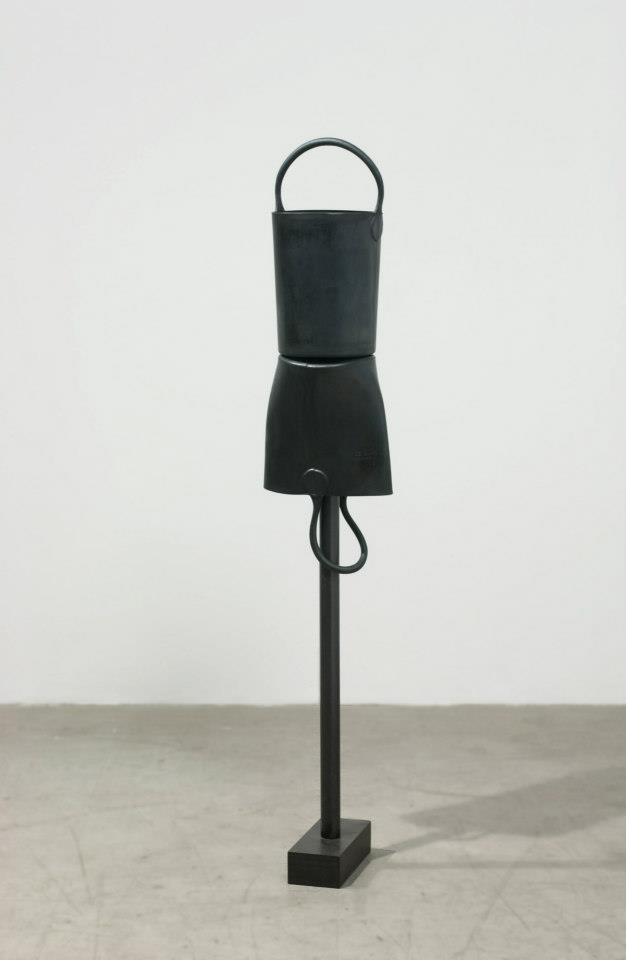 "Jeff Spaulding  Bucket Girl   2001 Neoprene rubber, steel with gunmetal bluing 55"" x 10.25"" x 7"""