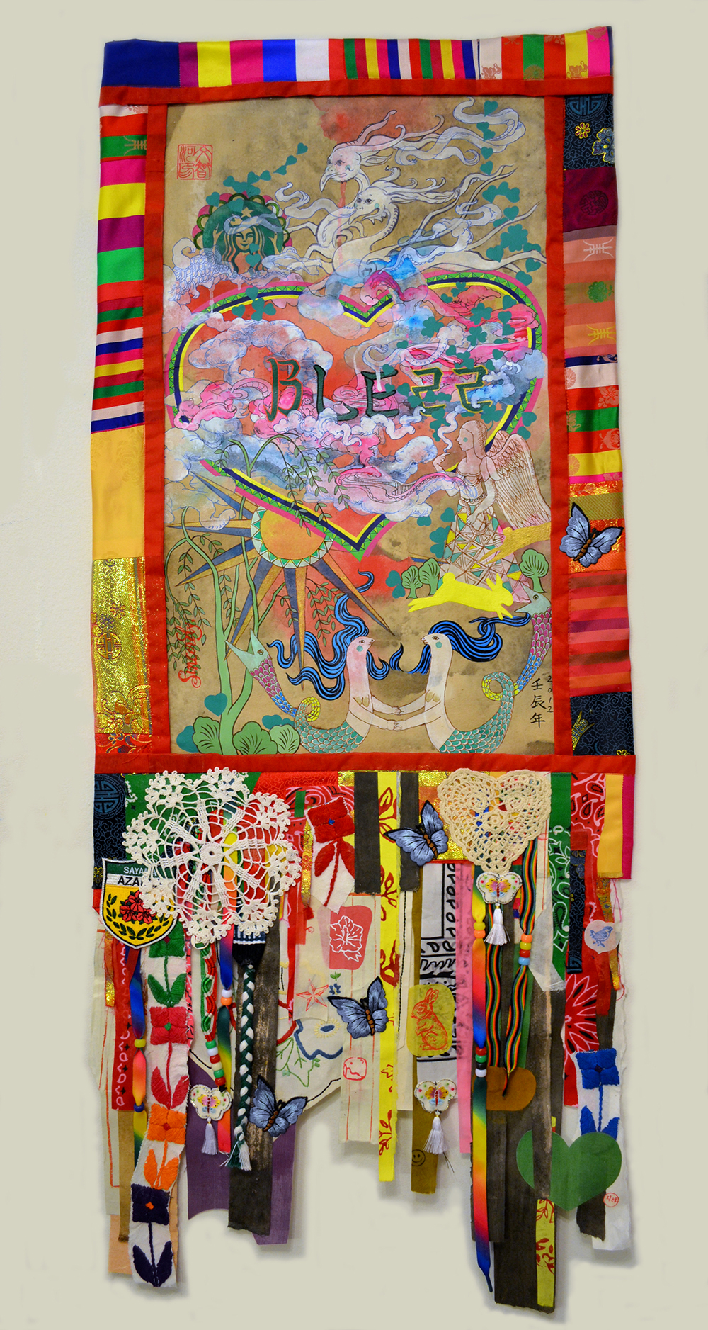 "Jiha Moon  Double Bless  Ink and acrylic on Hanji paper, shoelaces, doily, pony beads, quilted border 41"" x 16.75"" 2012"