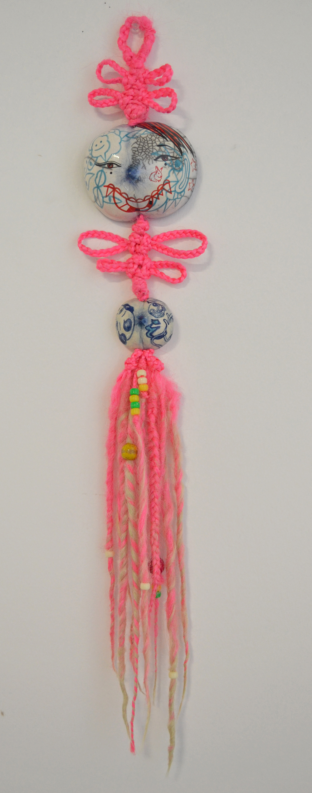 "Jiha Moon  New Bride  Ceramic, hand-knotted synthetic hair, pony beads, thread 28"" x 5"" x 2.25"" 2013"
