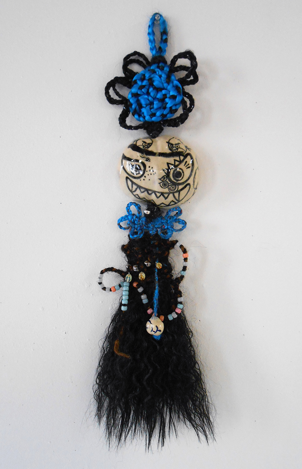 "Jiha Moon  Blue Maria  Ceramic, hand-knotted synthetic hair, pony and plastic beads, found objects, wire 26"" x 6"" x 3"" 2014"