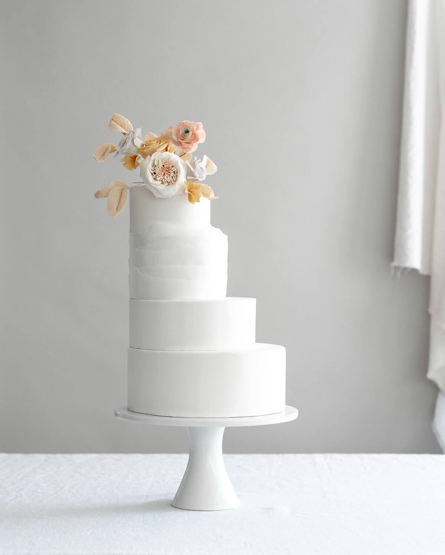 assymetrical tiered wedding cake handmade sugar flowers.jpg