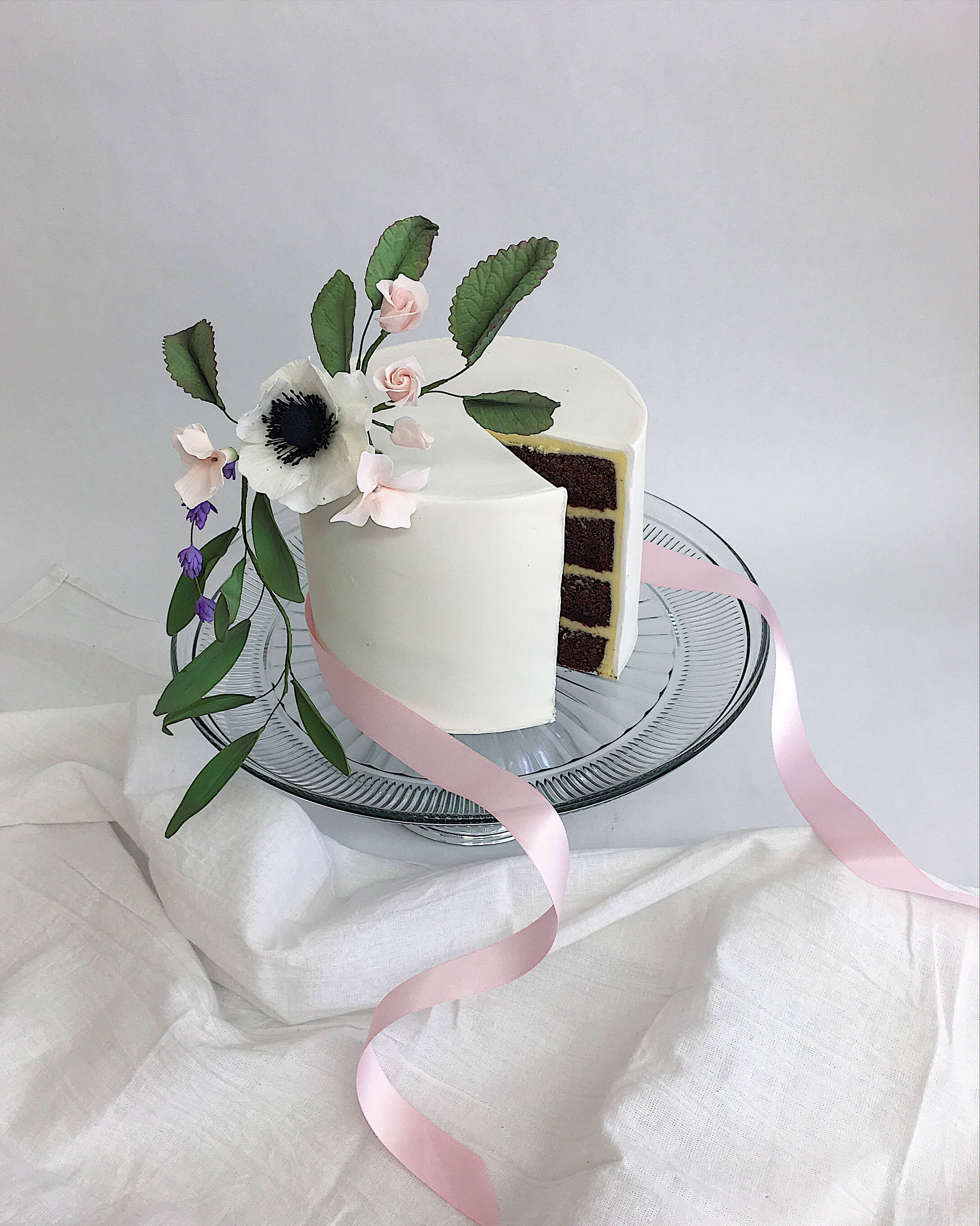 fondant chocolate cake sliced sugar flowers .jpg