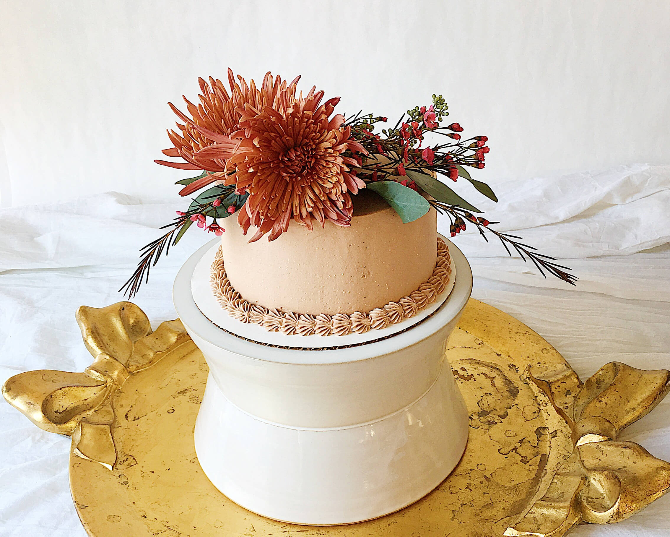 mocha buttercream layer cake romantic blooms.jpeg