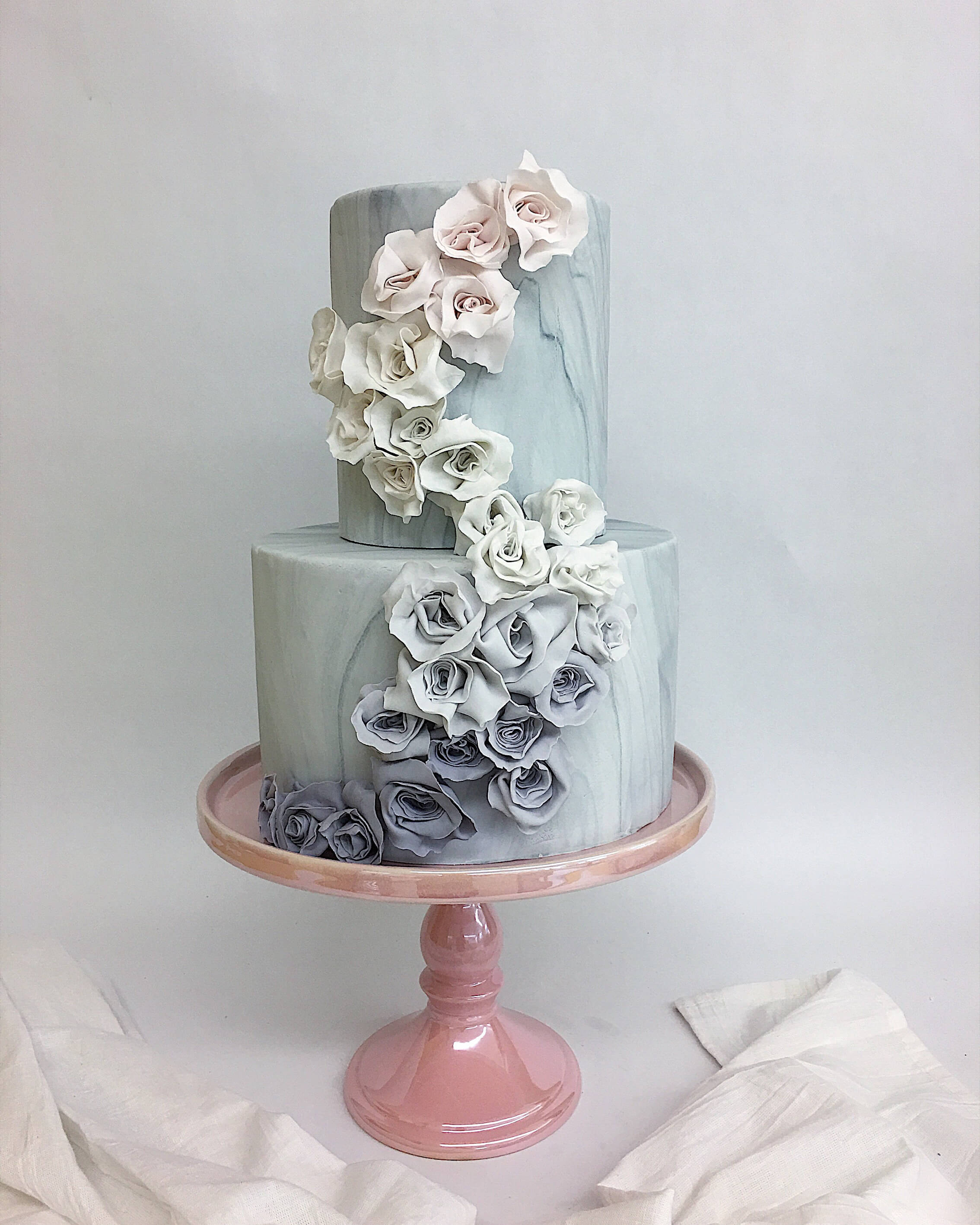 marble effect fondant rosettes tiered wedding cake.jpg
