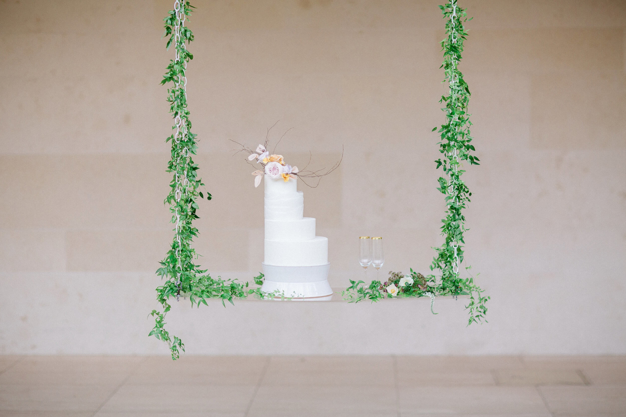 wisconsin bride wedding cake assymetrical on swing.jpg