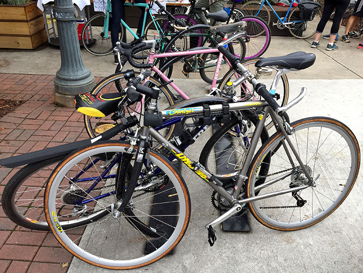 Classic Litespeed, and there's the cool pink Schwinn further down. Giro stylz.