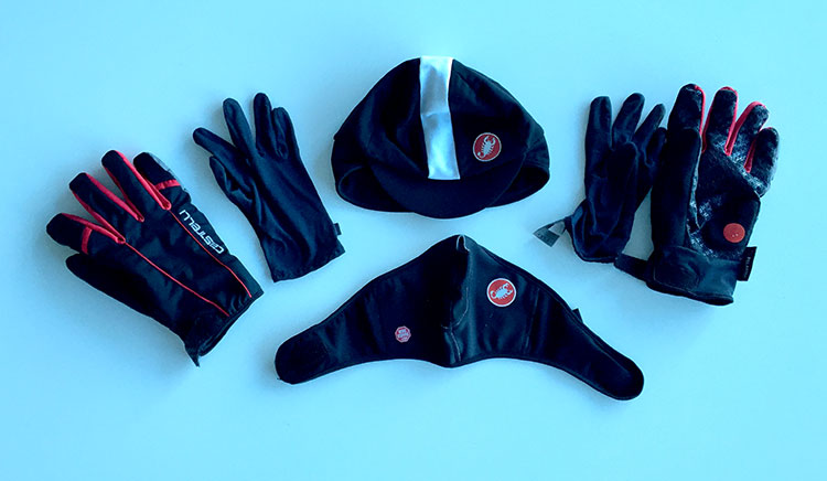 Hat with extra insulation, winter glove with glove lining, and face mask.