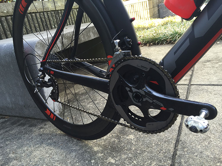 The red paint accents on the SRAM Red components are the exact same red as on the wheels and frame, leading me to believe it's a custom paint job.