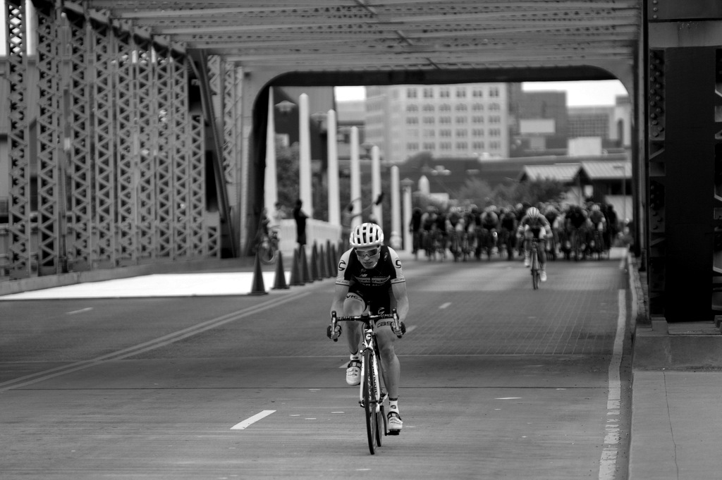 """Bridge"" I like the artistic components about this one. It also tells the story about the one rider in the break and one attempting to bridge the gap."