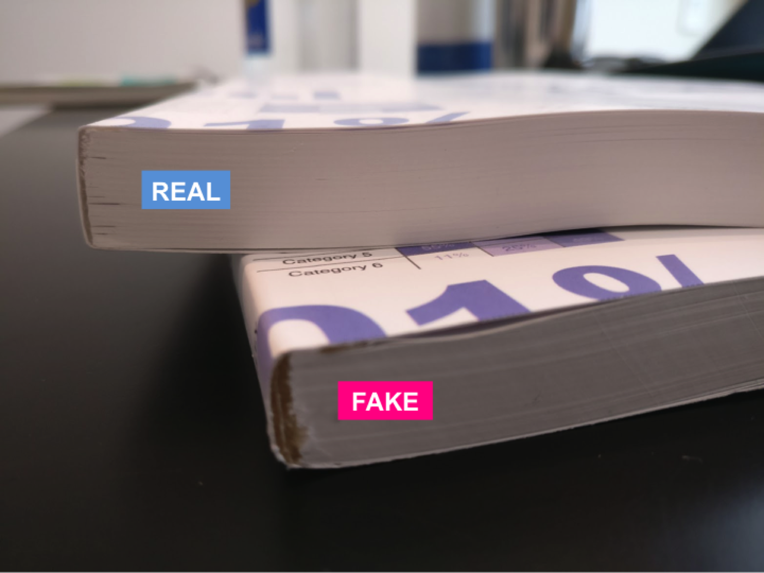 BINDING : The fake has sloppy binding with visible glue and is also thinner due to lower paper quality compared to the real book.