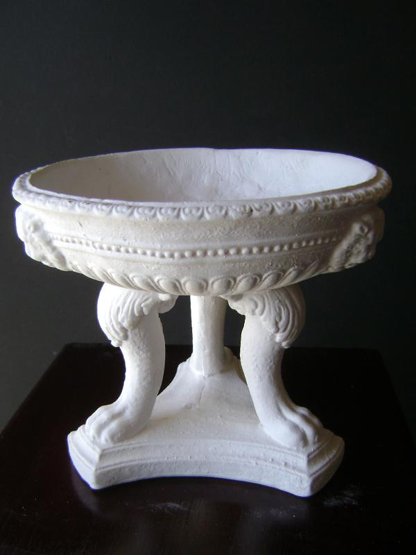 Plaster footed urn