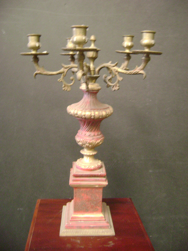 Brass and red candelabra