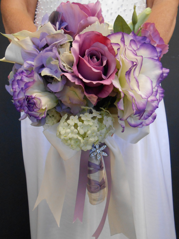 Bridal bouquet in lavender and purple with fancy handle