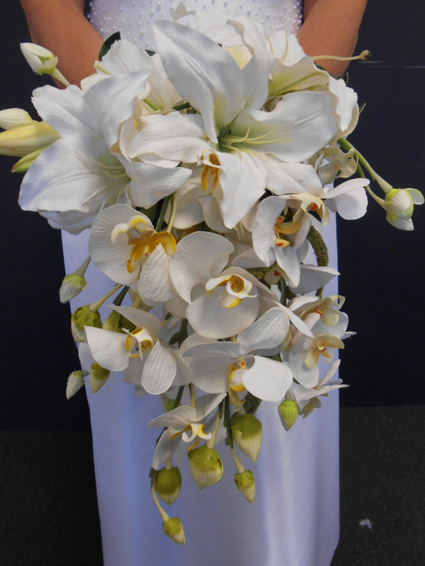 Bridal bouquet cascade with orchids and lilies