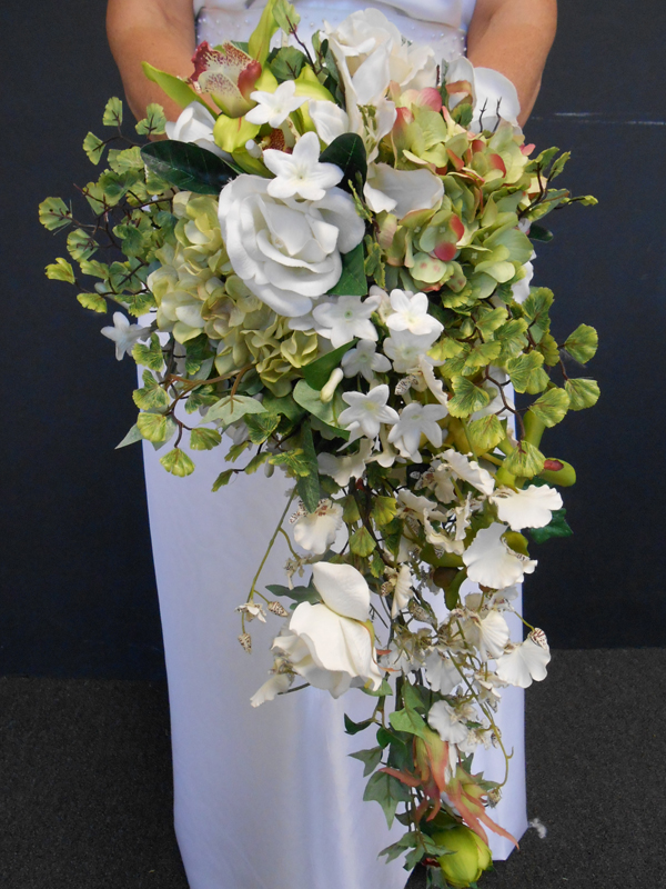 Orchids and greenery cascade bouquet